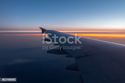 484616224 istock photo Wing of an airplane flying above the clouds 802469592