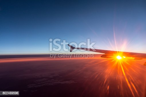484616224 istock photo Wing of an airplane flying above the clouds 802469596