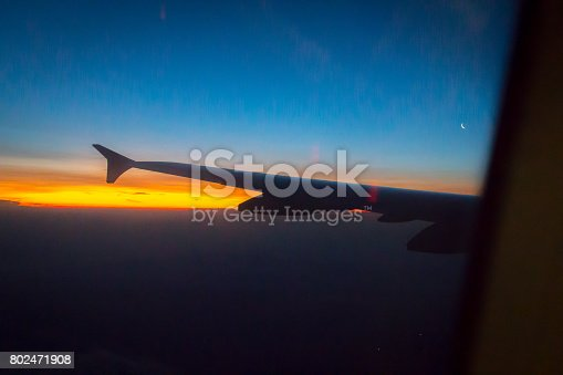 484616224 istock photo Wing of an airplane flying above the clouds 802471908