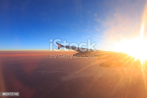 484616224 istock photo Wing of an airplane flying above the clouds 802472742