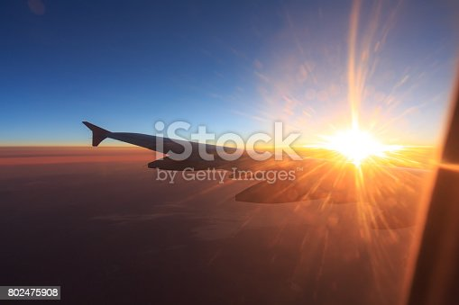 484616224 istock photo Wing of an airplane flying above the clouds 802475908