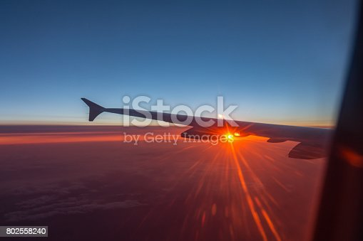 484616224 istock photo Wing of an airplane flying above the clouds 802558240