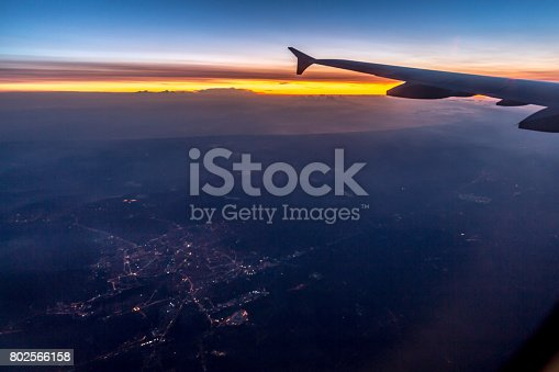 484616224 istock photo Wing of an airplane flying above the clouds 802566158