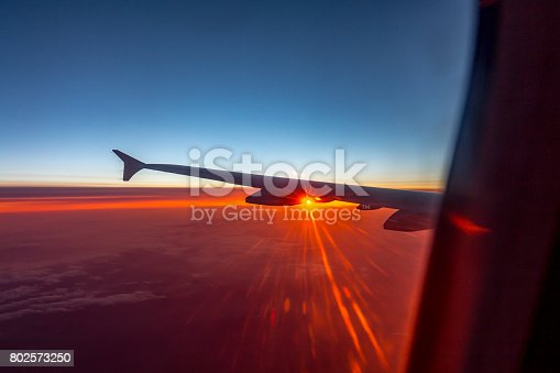 484616224 istock photo Wing of an airplane flying above the clouds 802573250