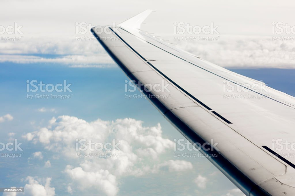 Wing of the plane on sky background. Lizenzfreies stock-foto