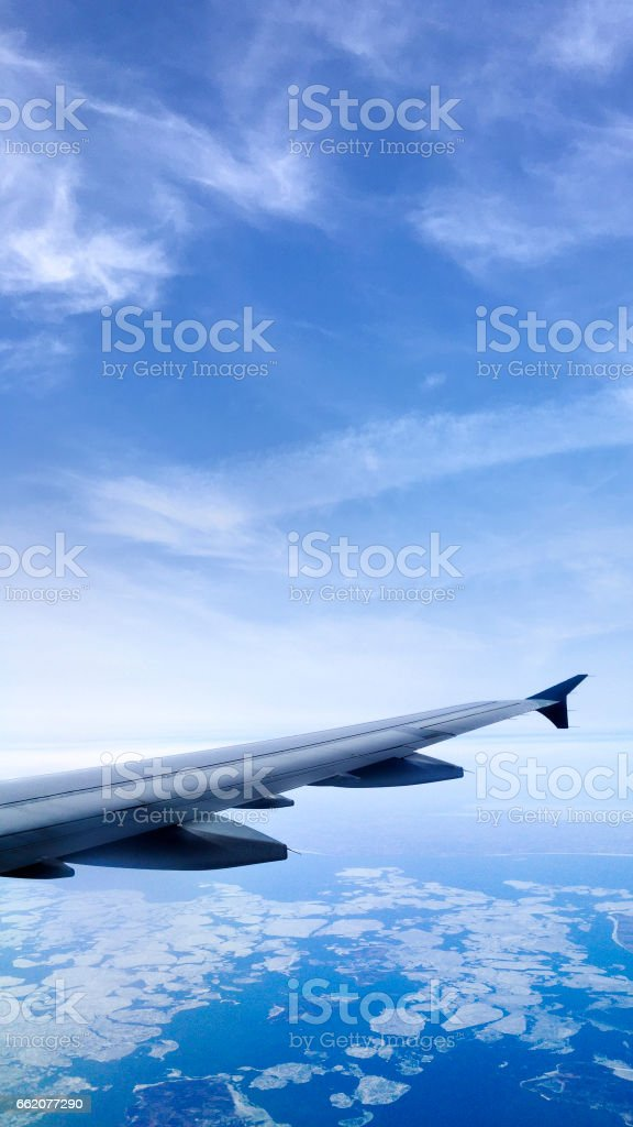 Wing over the earth's atmosphere royalty-free stock photo