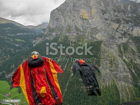 They fly down into valley in the Swiss Alps