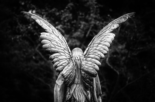 Winged angel gravestone back view