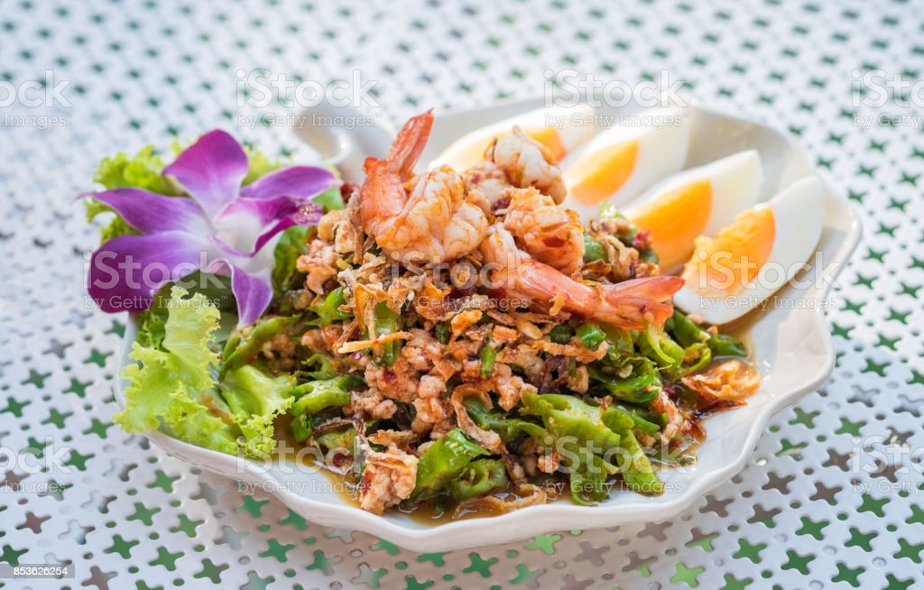 Winged bean spicy salad with shrimp, Thai food stock photo