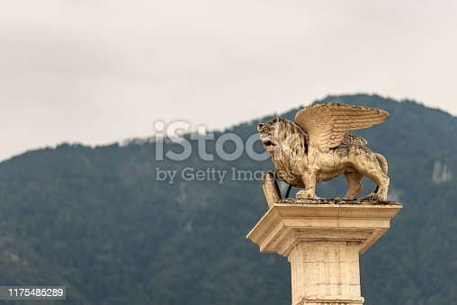 Winged lion of St Mark (Leone di San Marco) on the top of a column, symbol of the Venetian Republic. Piazza Maggiore, Feltre, Belluno province, Veneto, Italy, south Europe