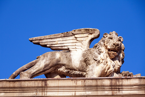 Winged lion statue at sunset in Libertà square  Udine Italy Detail