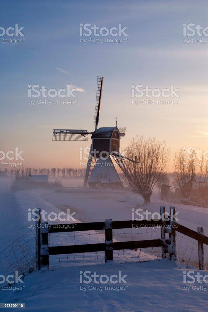 Wingerdse mill in wintermood stock photo