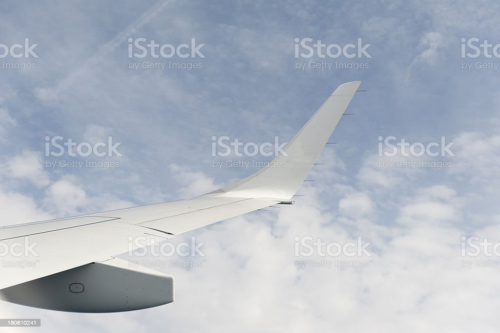 winglet of an embraer airplane in the air stock photo