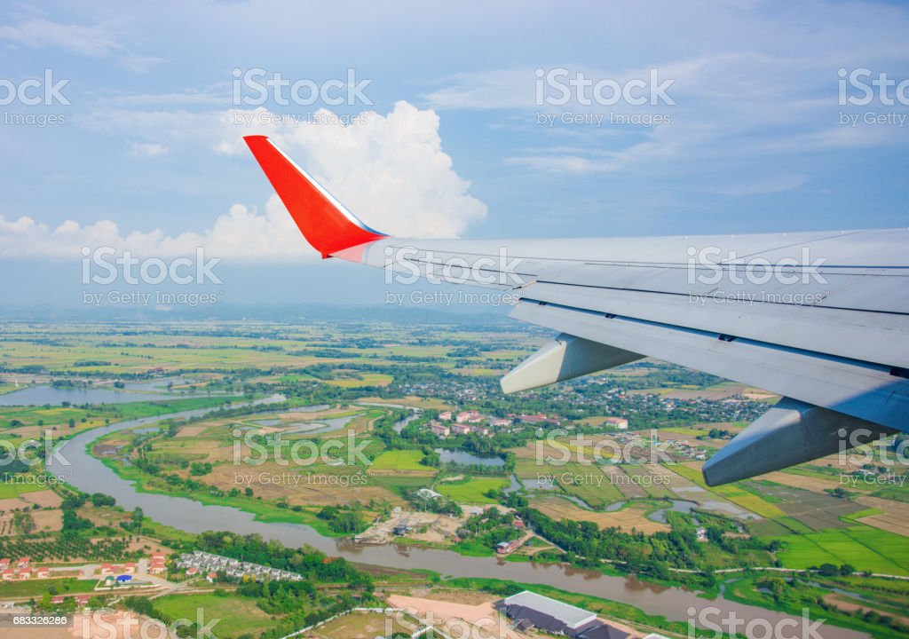 wings airplane on sky and landscape countryside royalty-free stock photo