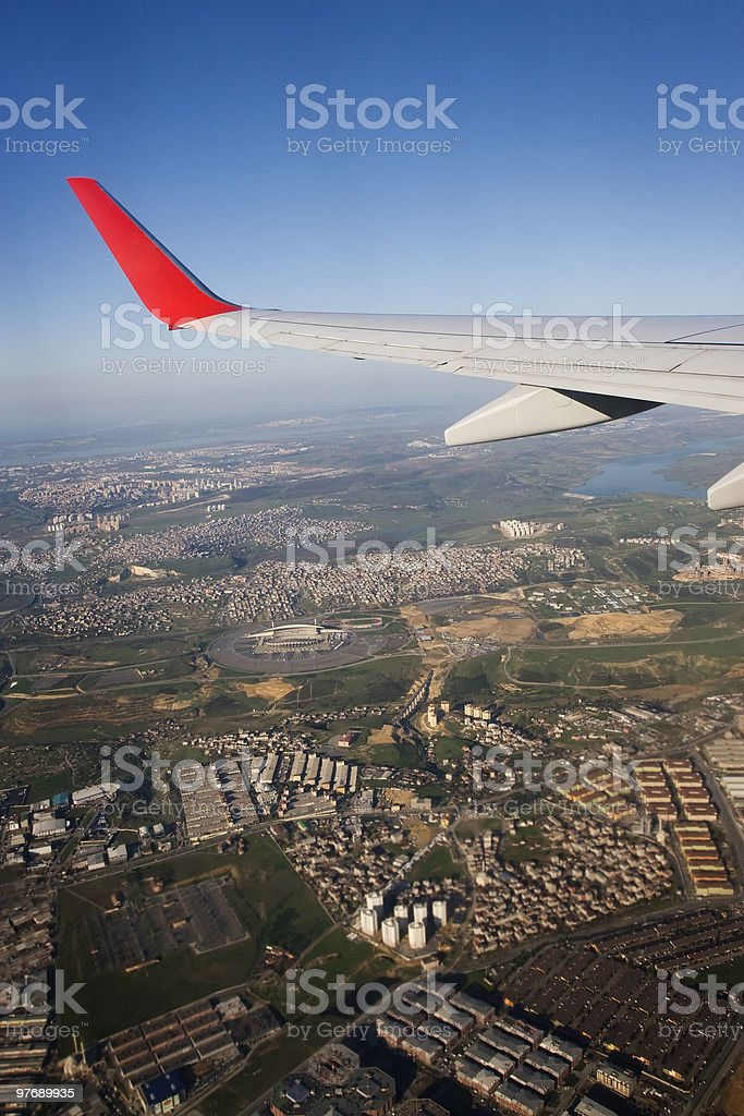 wings over city royalty-free stock photo