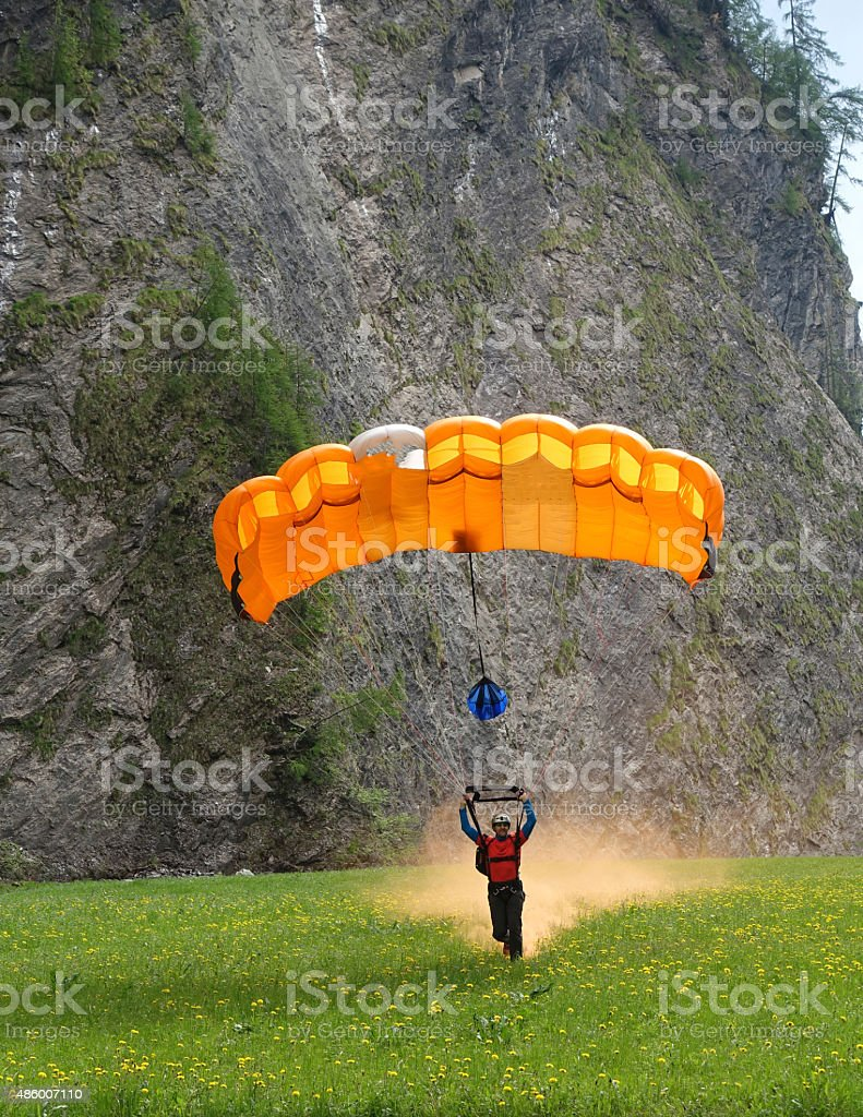 Wingsuit Flyer touches down in Bern Canton, Switzerland. stock photo