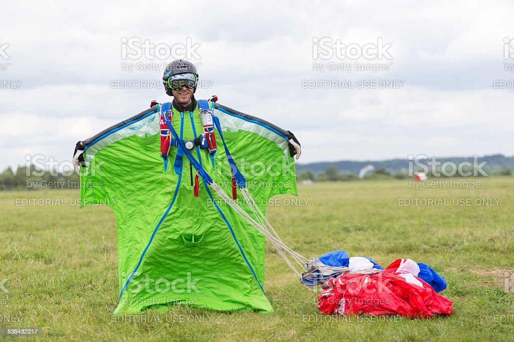 Wingsuit skydiver on  field at  Festival stock photo