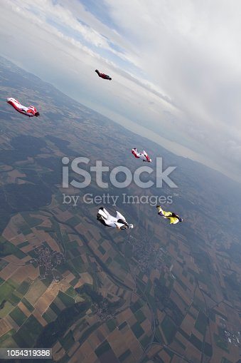 istock Wingsuiters dive through mid air 1054319386