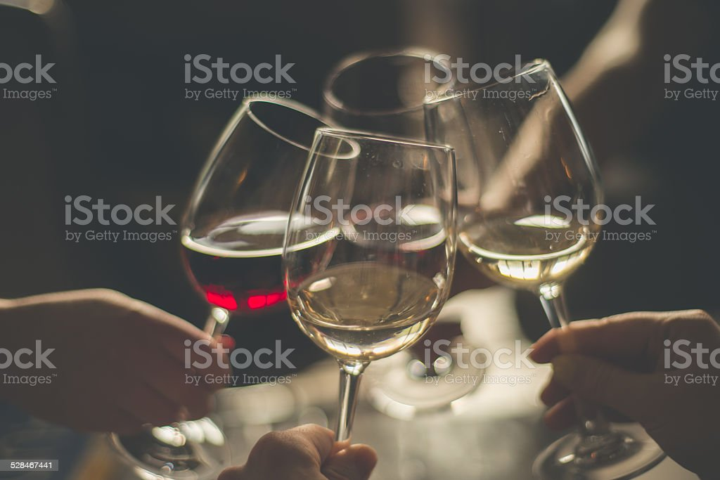 Wining with friends stock photo
