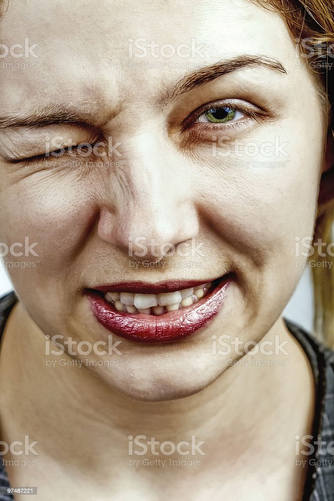 Wink - woman making a funny face royalty-free stock photo