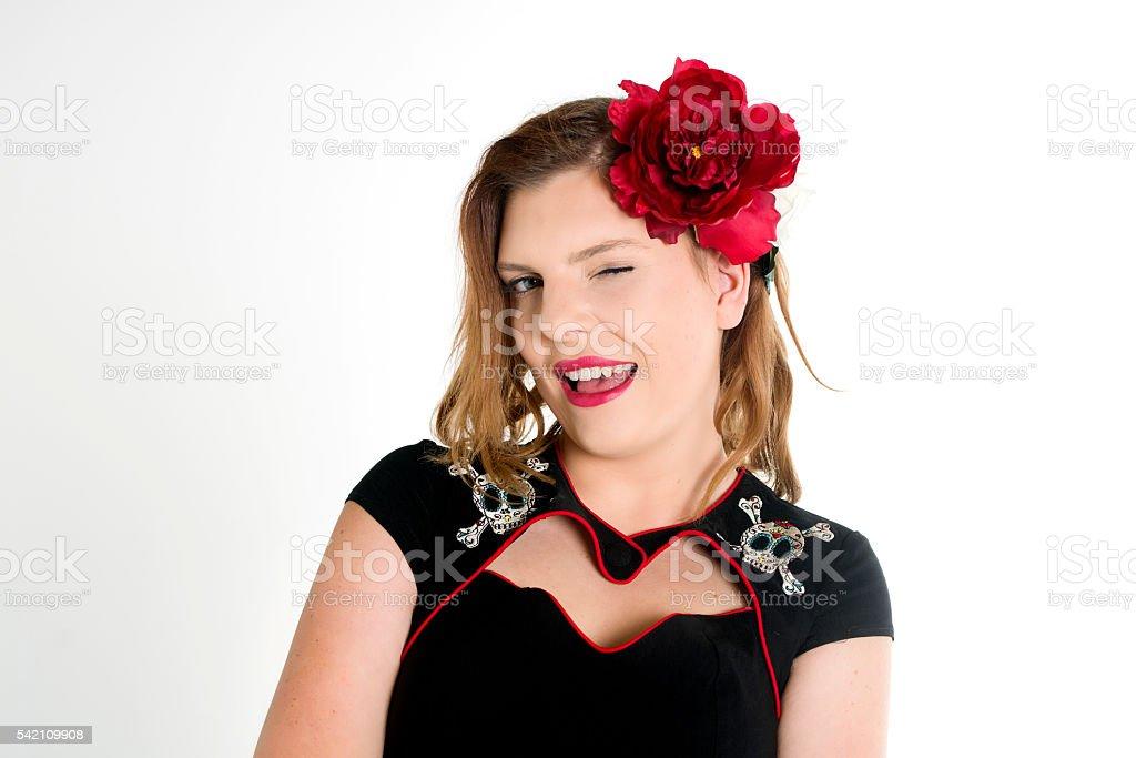 winking black dress stock photo