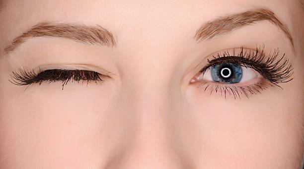 winking eye woman blue eyes winking. false eyelash stock pictures, royalty-free photos & images