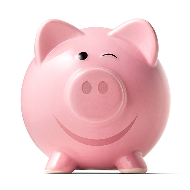 Winking piggybank on white background stock photo