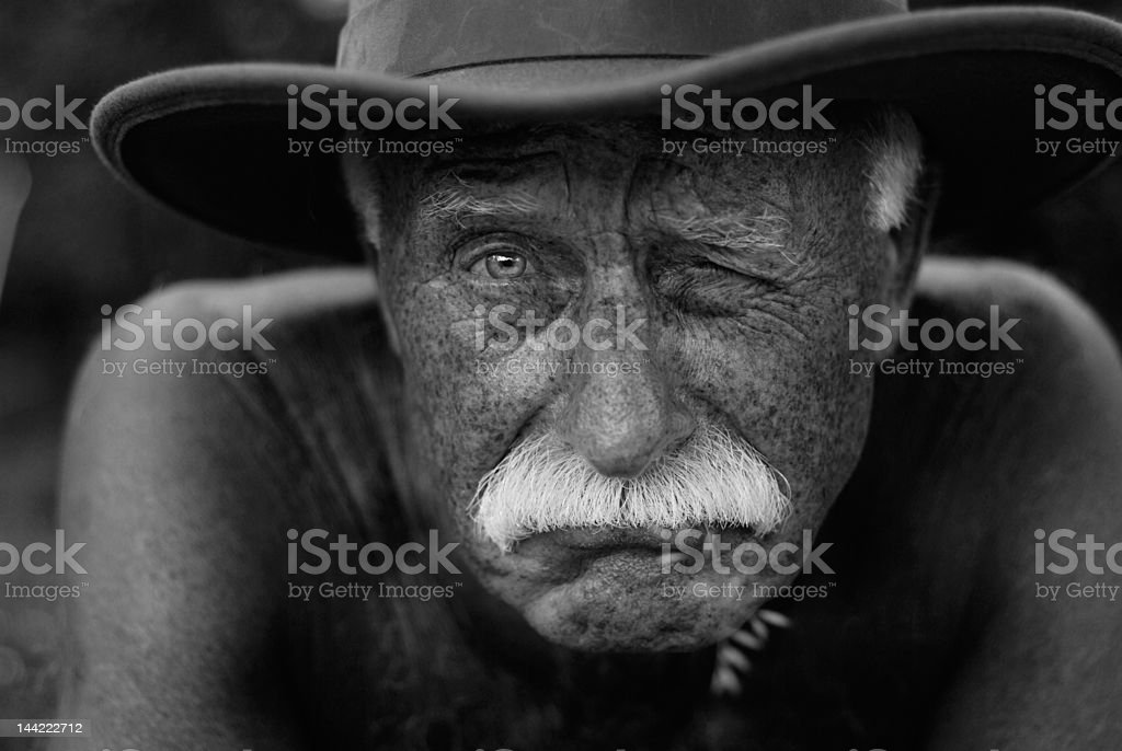 winking senior man stock photo