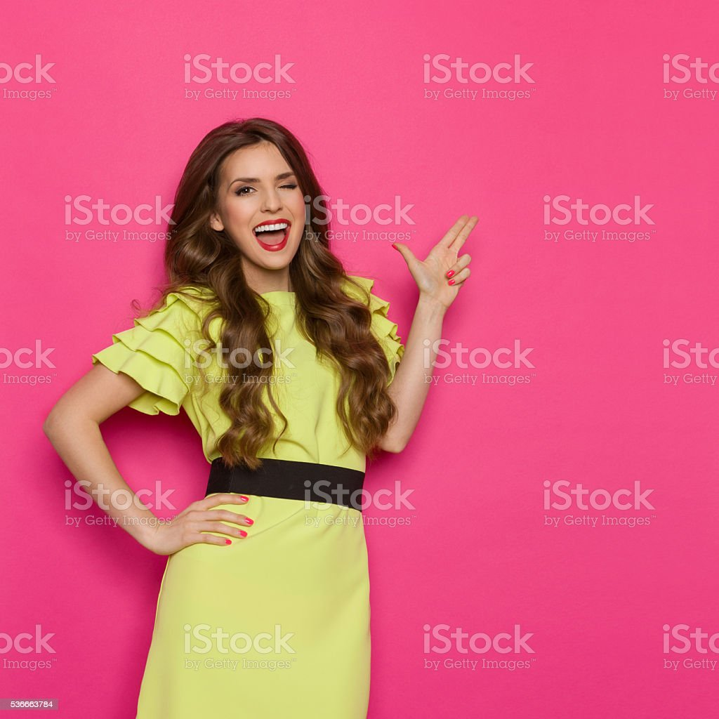 Winking Woman Shouting And Pointing stock photo