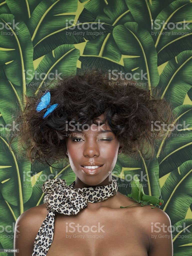 Winking woman with butterfly in her hair royalty-free 스톡 사진