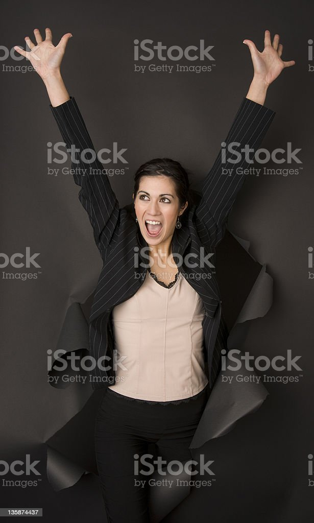Winner Attractive Business Woman Breaks Through Paper Barrier Successfull royalty-free stock photo
