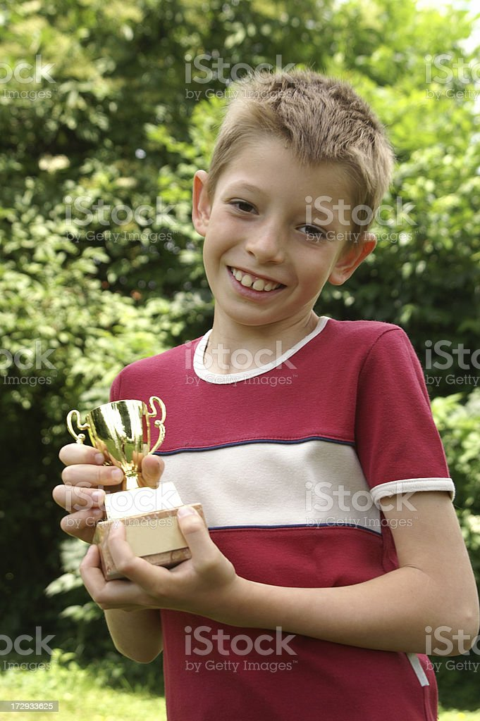 Winner - child with a cup stock photo