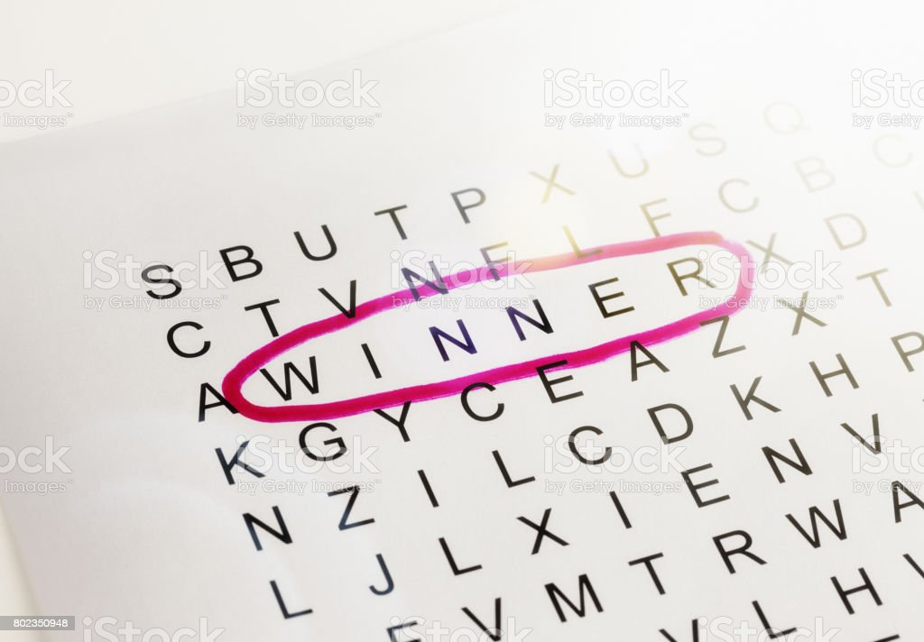 'Winner' circled in red on page of jumbled letters stock photo