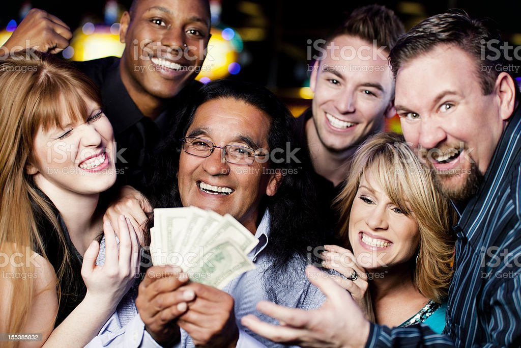 Winner: large group of happy diverse people celebrating a win royalty-free stock photo