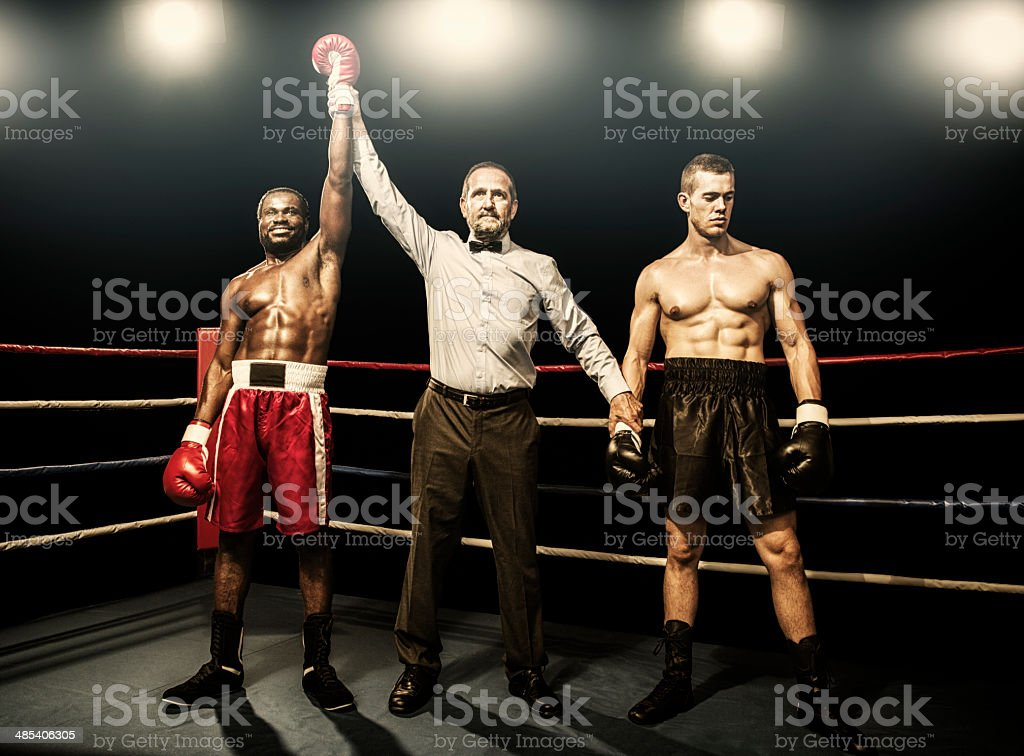 Winner of the boxing fight Referee raining arms of the winner Boxing - Sport Stock Photo