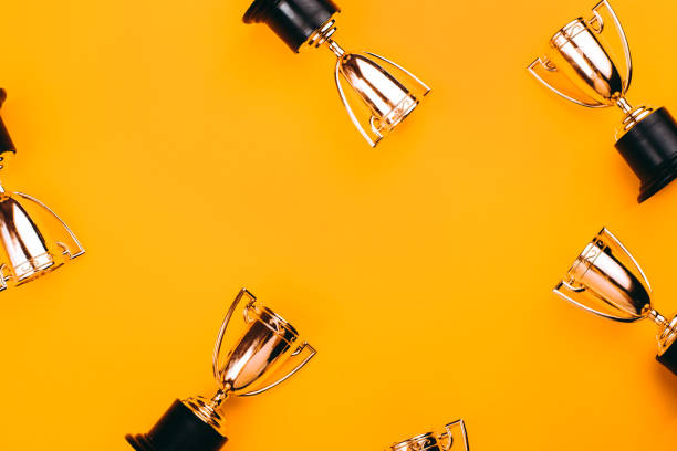 Winner or champion cup. Winner or champion cup on bright background, Flat lay style. Open composition. trophy award stock pictures, royalty-free photos & images