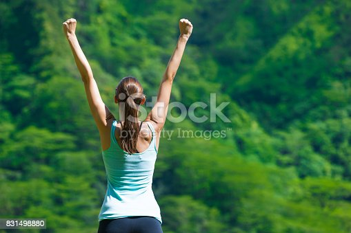 Woman celebrating her achieved goals.