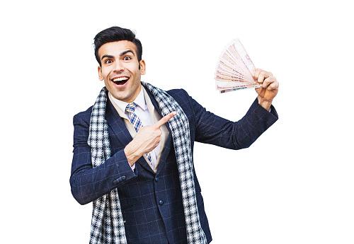 Happy man showing money he won in a lottery