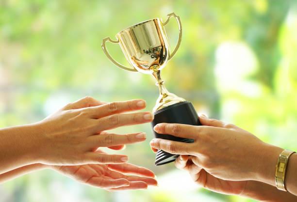 Winner receive trophy on blur green background picture id1023597038?b=1&k=6&m=1023597038&s=612x612&w=0&h=u5la7wedhcbpfxmbkkxmpifvbq6yt2pe0iqljmvqtfa=