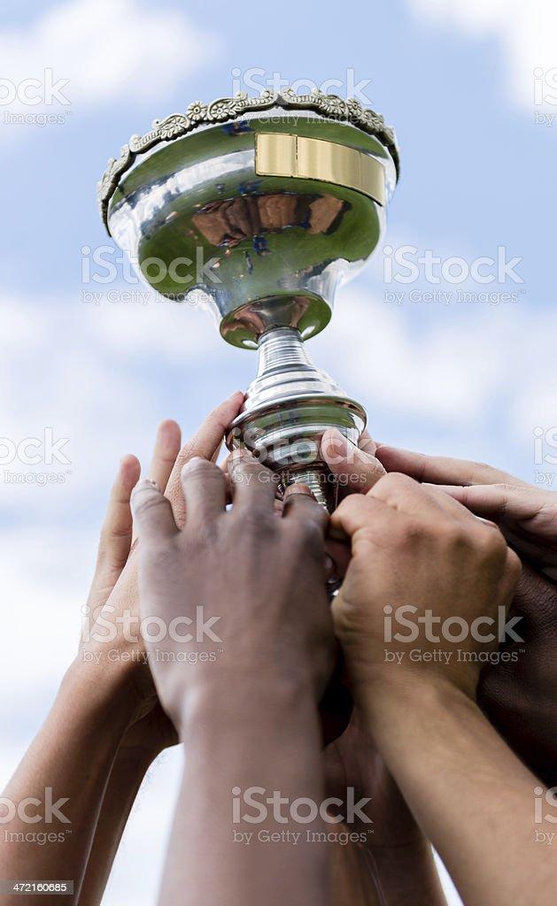 Winner team lifting a trophy stock photo