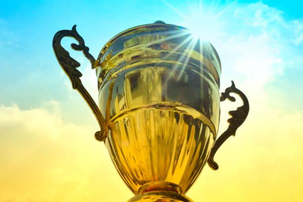 Winner trophy on sky background stock photo