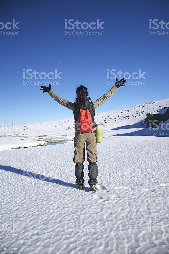 winner winter hiking woman stock photo