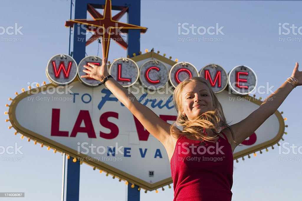 Winner with arms outstretched in front of Las Vegas sign royalty-free stock photo
