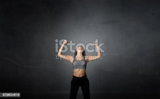 629605142istockphoto winner with arms up 629604816