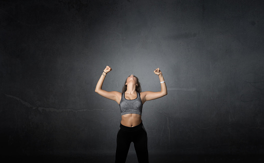 629605142 istock photo winner with arms up 629604816