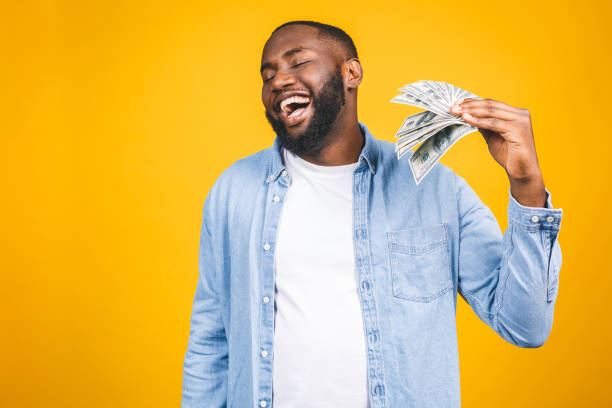 3,625 Black People Holding Money Stock Photos, Pictures & Royalty-Free Images - iStock