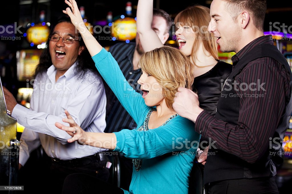 Winners: friends excited about hitting a jackpot in the casino stock photo