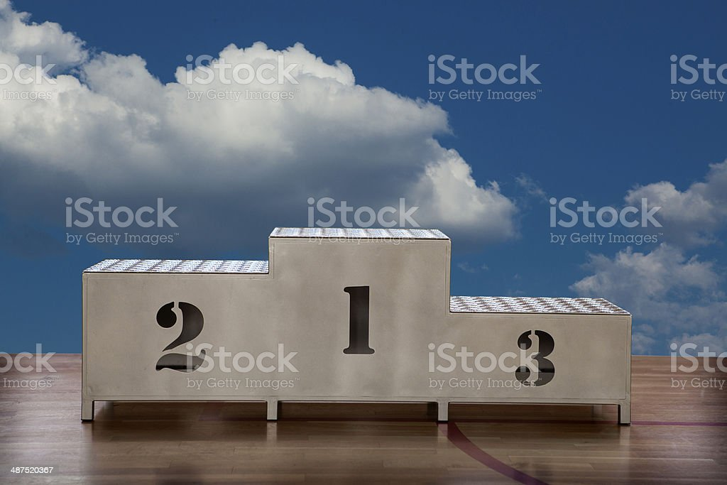 Winners podium with numerals on the sky royalty-free stock photo
