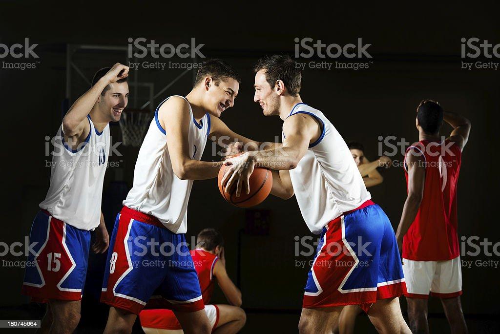 Winning basketball team celebrating their victory. royalty-free stock photo
