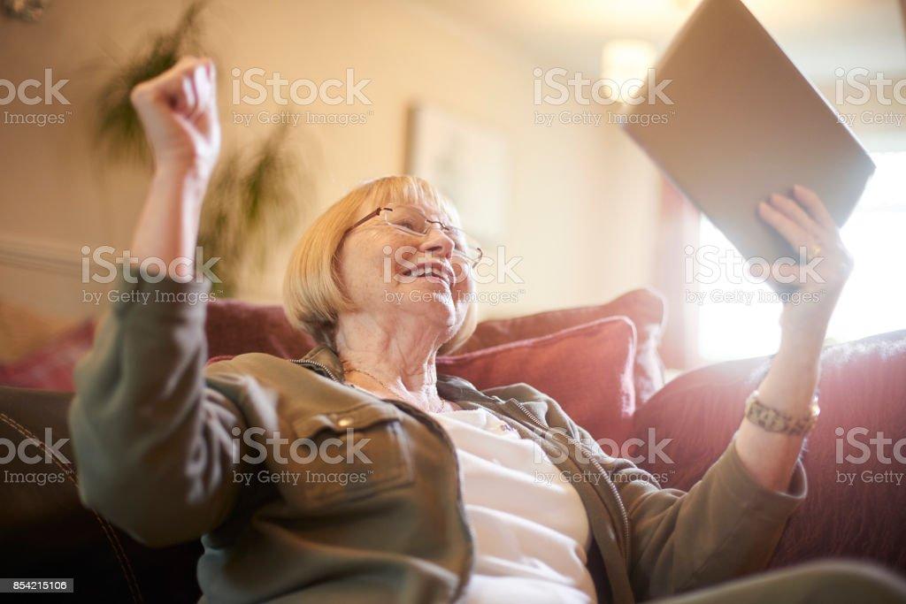 Winning big at online bingo stock photo